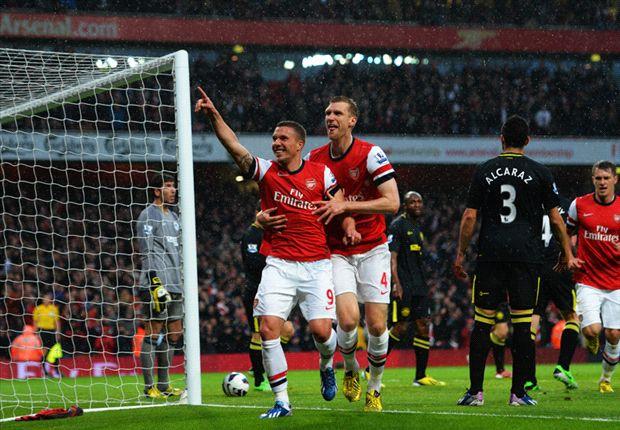 Lukas Podolski bringt den FC Arsenal gegen Wigan Athletic auf Kurs für die Champions League