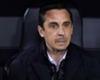 Neville delays England link-up