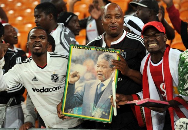South African football fans with a poster of Nelson Mandela