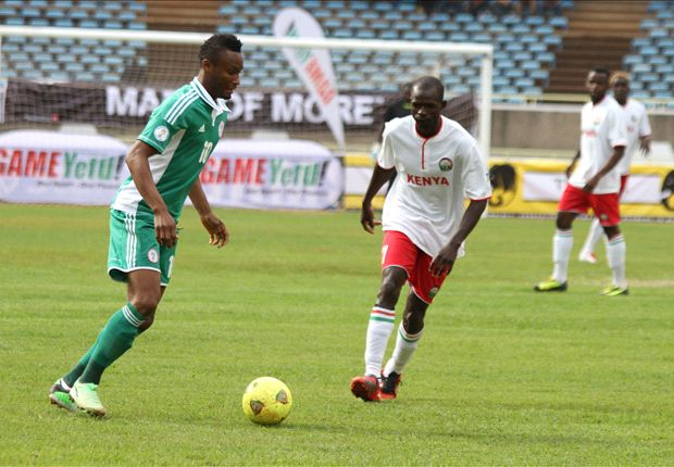 Kenya midfielder Peter Opiyo takes on John Obi Mikel at Kasarani on Wednesday