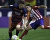 Messi at ease with Filipe Luis tackle
