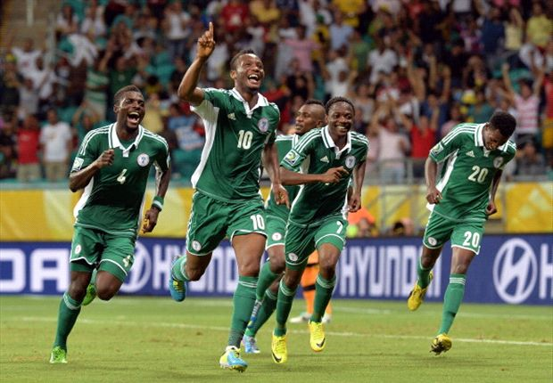 Mikel celebrates his equalising goal against Uruguay