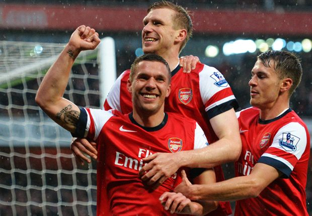 Arsenal striker Podolski welcomes pursuit of 'big player' Suarez