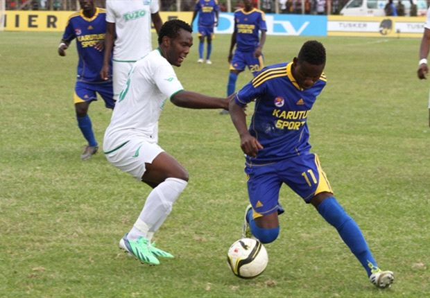 Gor Mahia player battles for the ball with a Karuturi Sports opponent on Sunday