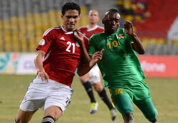Egypt's Mohammed Nagieb vies for the ball against Zimbabwe's Denver Mukamba