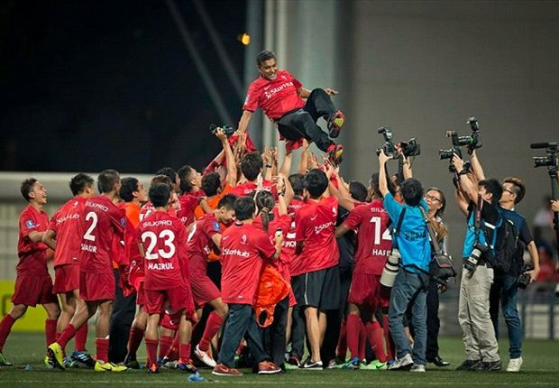 LionsXII players tossing coach Sundram into the air after winning MSL title.