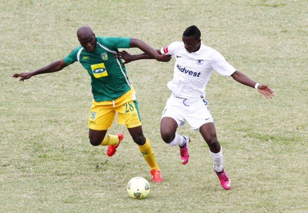 Musa Bilankulu of Golden Arrows with Papy Faty of Wits