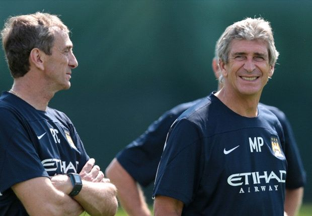 Kompany hails Pellegrini after first day in Manchester City job