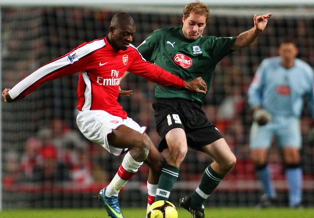 New Mariner Seip up against Arsenal's Abou Diaby