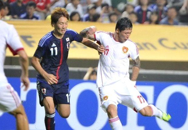 Cina dengan gigih menahan imbang Jepang 3-3 pada Kejuaraan Asia Timur 2013.