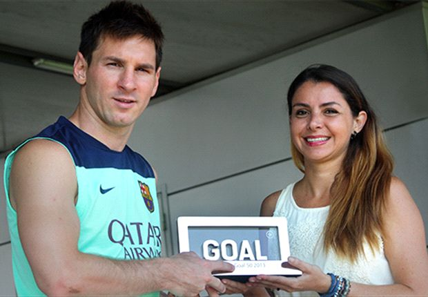 Lionel Messi receives the trophy from Goal's Barcelona writer Pilar Suarez