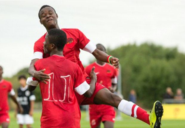 The Ghanaians celebrate their 10-goal romp at the Manchester United Premier Cup