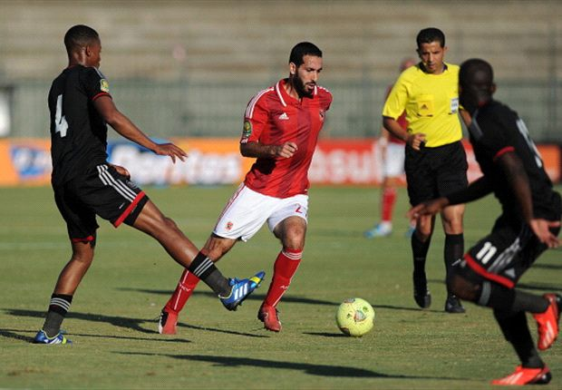 Al-Ahly's Mohamed Aboutrika dribbles toward Orlando Pirates defender Happy Jele