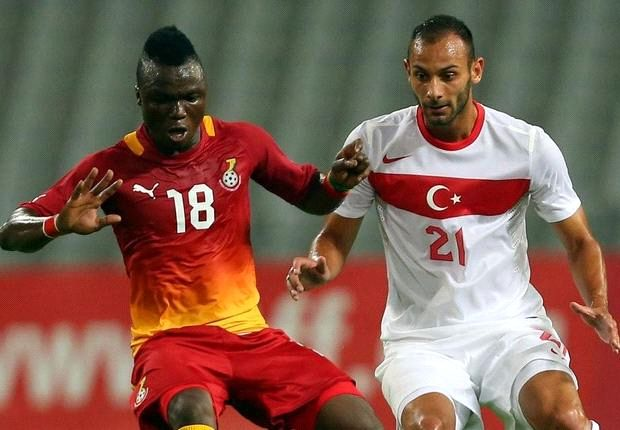 Dominic Adiyiah being challenged by Turkey's Omer Toprak