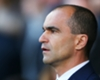Martinez ignores protests in win