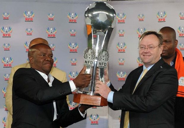 Polokwane City Chairman, Johnny Mogaladi (left) receiving the NFD Trophy from PSL CEO, Brand de Villiers