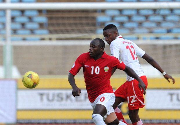 Kenya striker Dennis Oliech v Namibia opponent on September 8, 2014.