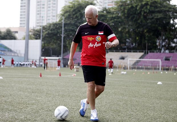 Singapore coach Stange at a kids' coaching clinic