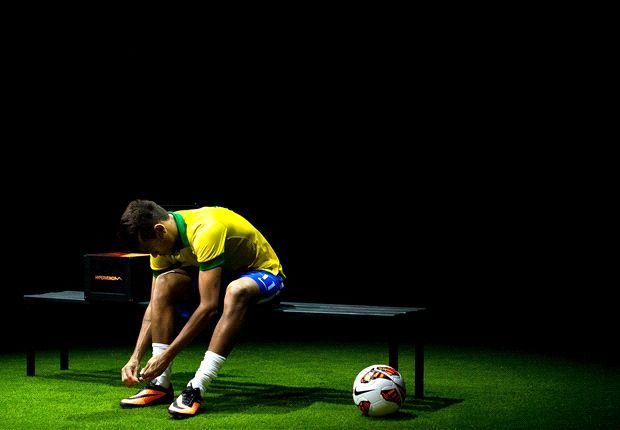 Brazil superstar Neymar putting on the new Nike Nypervenom boots