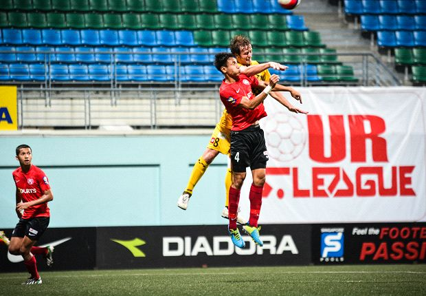 Centreback Afiq Yunos, in red, has been tipped by Aide to be key player at the year-end SEA Games