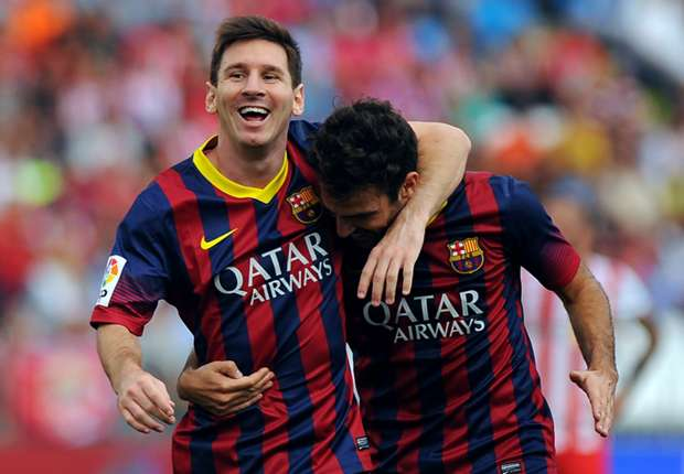 Lionel Messi celebrates following a goal against Almeria