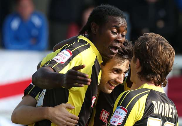 Burton Albion players celebrate a goal