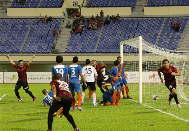 DPMM players wheel away to celebrate after scoring the winner.