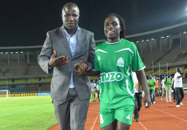 Gor Mahia secretary George Bwana and striker Dan Sserunkuma