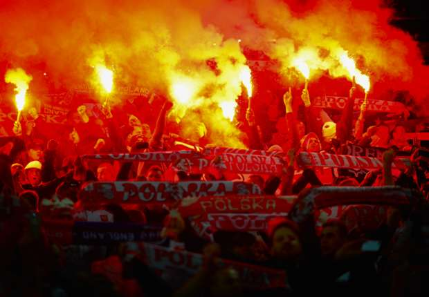 Poland fans let off flares