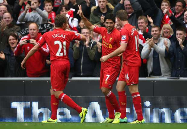 Luis Suarez celebrates against West Brom