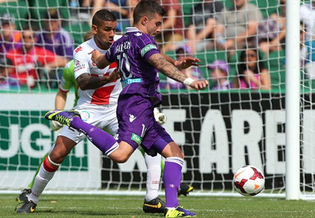 Goal-scorer Jamie Maclaren takes on Patrick Kisnorbo