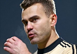 Russia goalkeeper Igor Akinfeev was the centre of an unsavory storm on Friday after being struck by a flare during Russia's Euro 2016 qualifier with Montenegro.