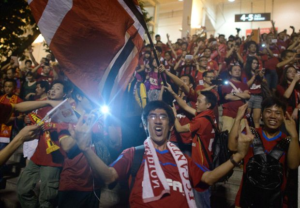 Evergrande supporters following the club's victory in the 2013 final
