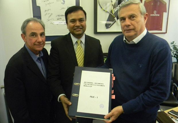 Sunando Dhar (centre) confirms two bids for the I-League participation