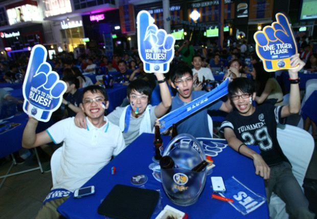 Fans enjoying the night with ice cold Tiger Beer.