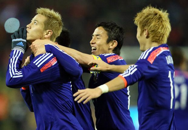 Japan celebrate a goal against Belgium in a recent friendly.