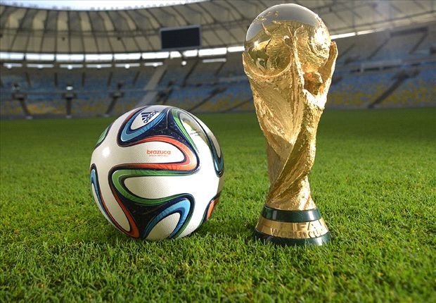 The World Cup trophy and the official ball for the 2014 tournament.