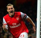 Bendtner & Ozil ease Arsenal past Hull