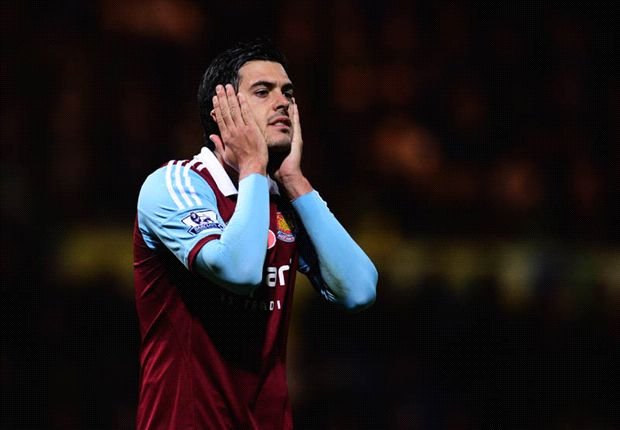Tomkins eager to face Liverpool strikeforce
