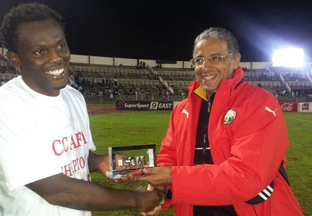 Kenya coach Adel Amrouche hands David Owino his Player of the Year Award