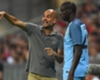 Pep Guardiola and Yaya Toure of Manchester City