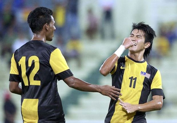 Rozaimi celebrates his goal against Singapore.