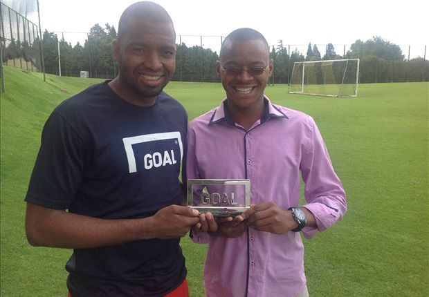 Goal's Ernest Makhaya hands Itu Khune his Player of the Year Award
