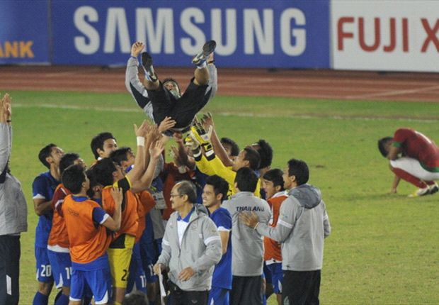 Thailand coach Kiatisuk Senamuang hoisted into the air by his players after they won gold.