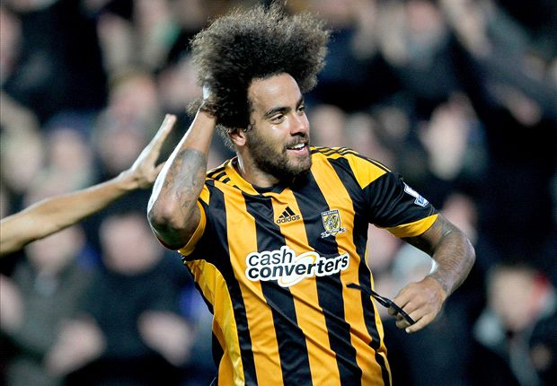 Manchester City go top & Huddlestone gets a haircut: The Premier League in pics