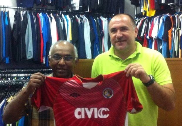 Club chairman S. Thavaneson (left) with his new coach.