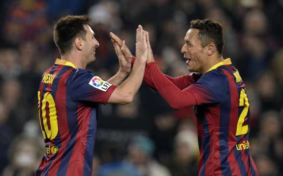 Barcelona team-mates Lionel Messi (L) and Adrian