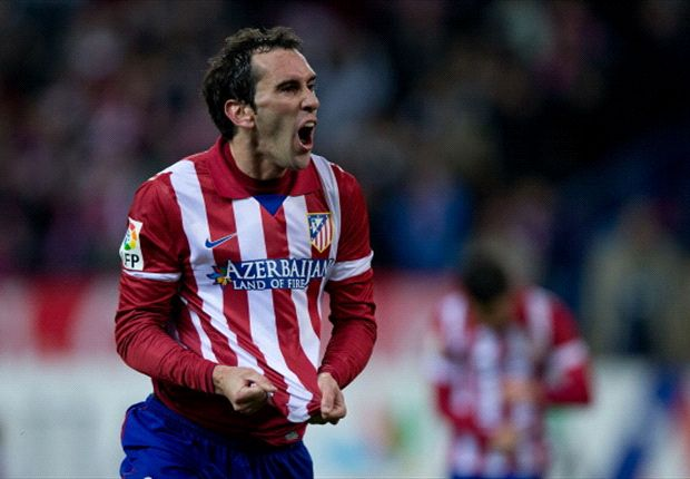 Atletico Madrid 2-0 Valencia (agg 3-1): Godin & Garcia deliver for Simeone's men