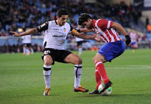 Atletico Madrid 2-0 Valencia (agg 3-1): Godin and Garcia deliver for Simeone's men