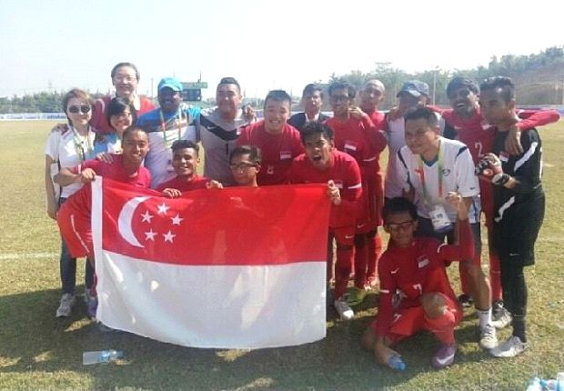 The Singapore Cerebral Palsy side give winning poses after beating Thailand.